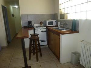 A kitchen or kitchenette at Departamentos Cotecal