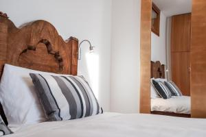 A bed or beds in a room at Casa Calvola