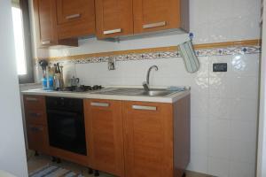 A kitchen or kitchenette at Appartamento Rosa Virginia