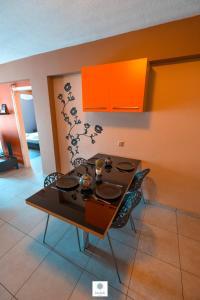 A kitchen or kitchenette at Tasos Apartment