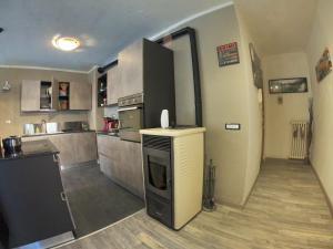 A kitchen or kitchenette at Maison Royale