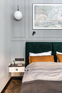 Кровать или кровати в номере Апартаменты улица Чайковского 77