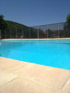 The swimming pool at or near Chalets Gîtes La Croisée des Chemins