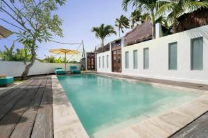 The swimming pool at or near The Apartments Canggu