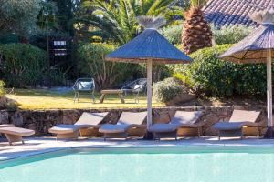 The swimming pool at or near Résidence Les Toits de Santa Giulia
