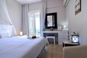 A bed or beds in a room at Corfu Sea View Rooms