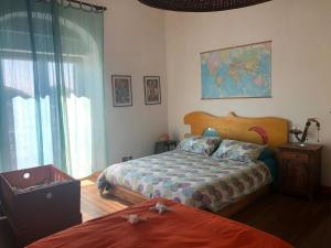 A bed or beds in a room at San Saba Roof Top Garden