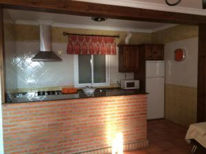 Una cocina o zona de cocina en Villa Gallardo