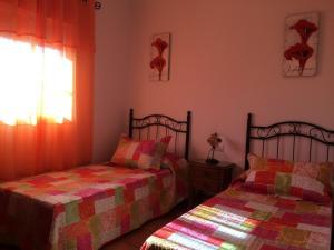 Cama o camas de una habitación en Villa Gallardo