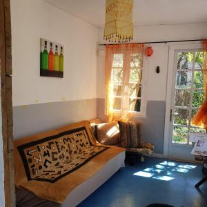 A bed or beds in a room at Les Marronniers