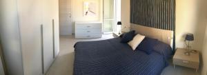 Letto o letti in una camera di Victoria Apartments