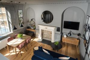 A television and/or entertainment center at Hiding Space - Trim Street Apartments