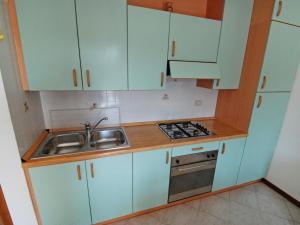 Kuchyň nebo kuchyňský kout v ubytování Locazione turistica Green