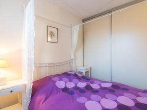 A bed or beds in a room at Apartment Le Grand Pavois