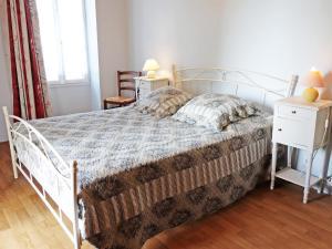 Un ou plusieurs lits dans un hébergement de l'établissement Holiday Home Le Logis du Chateau