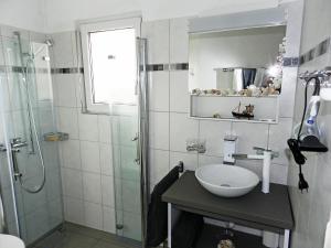 Ein Badezimmer in der Unterkunft Apartment Morgenstrasse