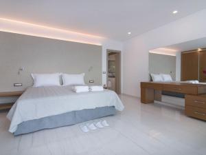 Ein Bett oder Betten in einem Zimmer der Unterkunft Villa Villa Aurora