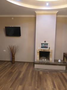 A television and/or entertainment center at Apartment Gorgiladze 66