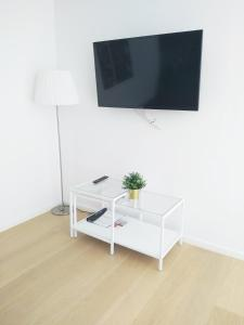 A television and/or entertainment center at Vienna Garden Residence