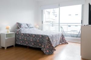 A bed or beds in a room at Luminoso y cálido Estudio en Palermo zona Botánico