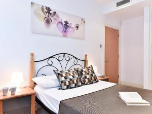 A bed or beds in a room at Apartment Prospero.2