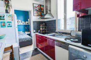 A kitchen or kitchenette at HostnFly apartments - Superb apartment 2 steps from the Stade de France