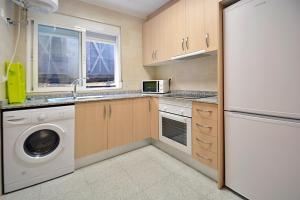 A kitchen or kitchenette at Apartamentos Plaza