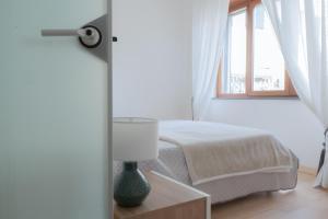 Postel nebo postele na pokoji v ubytování Atlantide holiday apartments