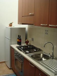 Una cocina o zona de cocina en Renda Apartments