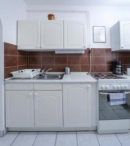 A kitchen or kitchenette at Angel Residence
