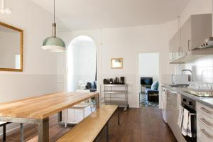 A kitchen or kitchenette at My Address in Barcelona