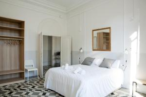 Letto o letti in una camera di My Address in Barcelona