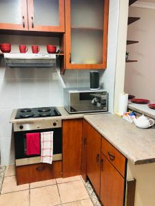 A kitchen or kitchenette at Lodge @ 134