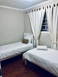 A bed or beds in a room at Lodge @ 134