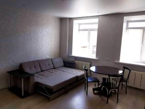 A seating area at Апартаменты на Юбилейной