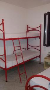 A bed or beds in a room at Casa Mare Sardegna Straulas