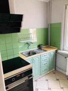 A kitchen or kitchenette at Lovely Apartments Gdańsk