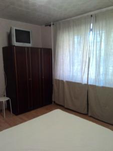 A bed or beds in a room at МИНИ КВАРТИРА ВОССТАНИЯ 123А