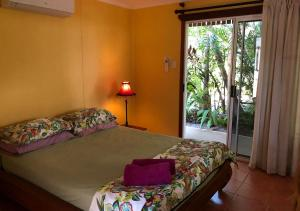 A bed or beds in a room at Rum Jungle Bungalows