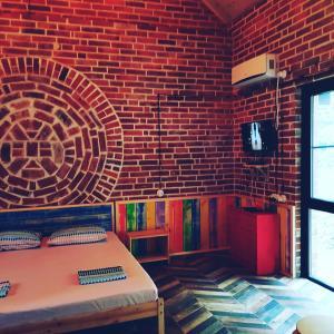 En eller flere senge i et værelse på Eco Loft