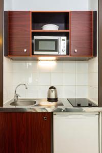 A kitchen or kitchenette at Aparthotel Adagio Access Paris Porte De Charenton