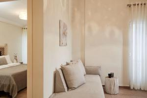 A seating area at Loizos Stylish Residences