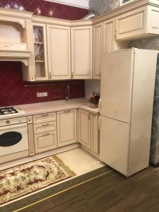 A kitchen or kitchenette at ALL THE BEST
