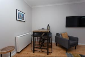 A television and/or entertainment center at Yorkhill West End Apartment