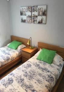 A bed or beds in a room at Residencial Aquamarinas