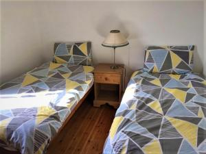 A bed or beds in a room at Baile Slievemore Holiday Homes