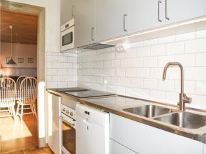 A kitchen or kitchenette at Holiday home Holmsjö Gård Holmsjö