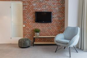 TV/Unterhaltungsangebot in der Unterkunft Appartementen Zeerust