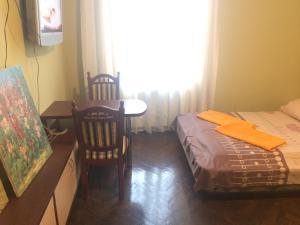 Ліжко або ліжка в номері Центрова квартира №2 біля пошти з усіма зручностями