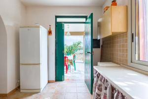 A kitchen or kitchenette at Ronna Grazia